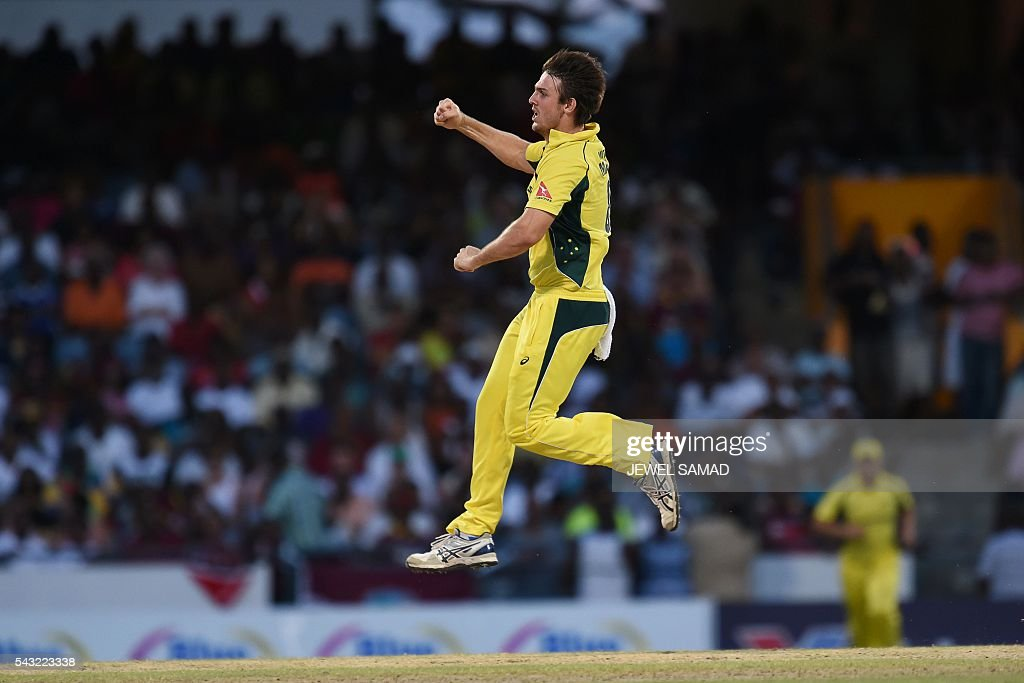 Australian cricketer Mitchell Marsh celebrates dismissing West Indies batsman Darren Bravo during the final match of the Tri-nation Series between Australia and West Indies in Bridgetown on June 26, 2016. / AFP / Jewel SAMAD