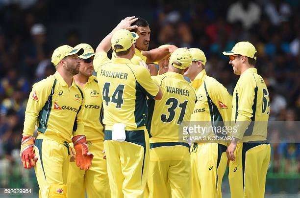 Australian cricketer Mitchell Starc celebrates with teammates after he dismissed Sri Lanka cricketer Kusal Perera during the first One Day...