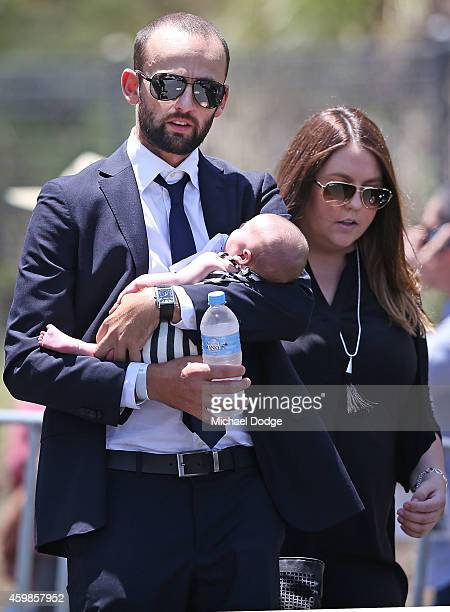 Australian cricketer Nathan Lyon arrives with his baby during the Funeral Service for Phillip Hughes on December 3 2014 in Macksville Australia...
