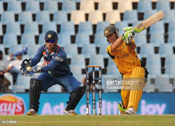 Australian cricketer Ricky Ponting swings at shot Mahendra Singh Dhoni tries to catch him out during The ICC Champions Trophy match between Australia...