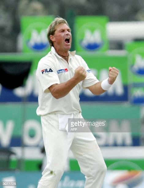 Australian cricketer Shane Warne gestures as he celebrates after dimissing Sri Lankan captain Hashan Tillakaratne bringing him to a total of 500 Test...