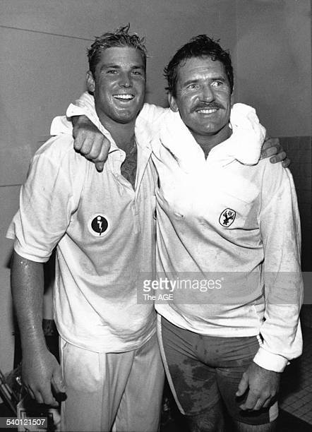 Australian cricketer Shane Warne is hugged by skipper Allan Border after he was named man of the match in the Second Test between Australia and the...