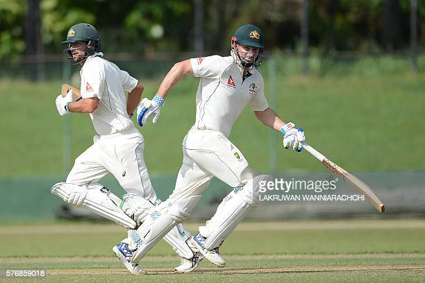 Australian cricketer Shaun Marsh and Joe Burns run between the wickets during the first day of a three day practice match between Australia and a Sri...