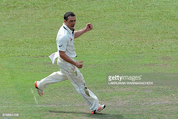 Australian cricketer Stephen O'Keefe celebrates after dismissing Sri Lankan XI cricketer Chaturanga de Silva during the first day of a three day...