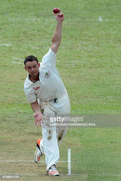 Australian cricketer Stephen O'Keefe delivers a ball during the first day of a three day practice match between Australia and a Sri Lankan XI team at...