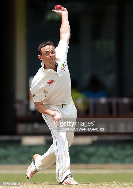Australian cricketer Stephen O'Keefe delivers the ball during the third day of a three day practice match between Australia and Sri Lankan XI team at...