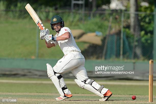 Australian cricketer Stephen O'Keefe plays a shot during the second day of a three day practice match between Australia and Sri Lankan XI team at the...