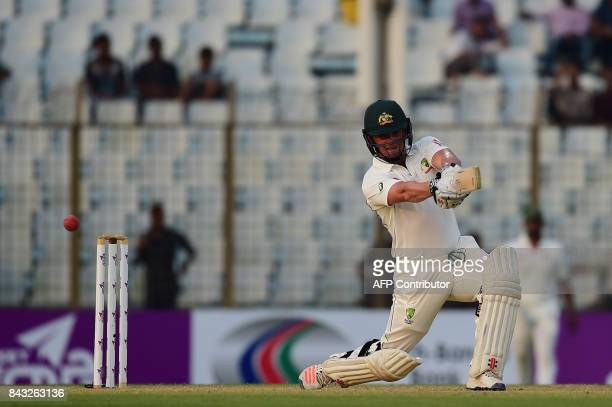 Australian cricketer Steve O'Keefe plays a shot during the third day of the second cricket Test between Bangladesh and Australia at Zahur Ahmed...