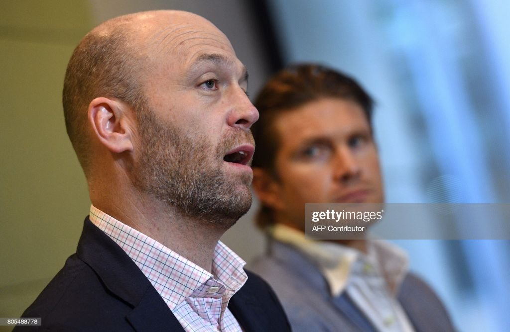 Australian Cricketers' Association (ACA) chief executive Alistair Nicholson (L) speaks as Australian cricket player Shane Watson (R) liatens during a press conference in Sydney on July 2, 2017. Players will boycott an Australia A tour of South Africa this month unless a new pay deal is agreed by Cricket Australia, the Australian Cricketers' Association said. The players' union held an emergency meeting in Sydney where they decided to take action for the tour beginning on July 12 unless a new Memorandum of Understanding (MOU) was signed. WEST