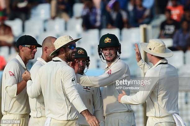 Australian cricketers celebrate after the dismissal of Bangladeshi cricketer Sabbir Rahman during the first day of the second cricket Test match...