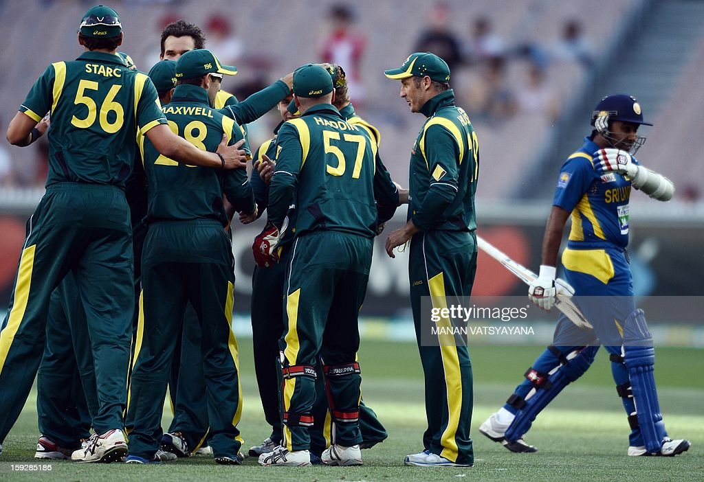 Australian cricketers celebrate the dismissal of Srilankan captain Mahela Jayawardena (R) during the first one-day international between Australia and Sri Lanka at the Melbourne Cricket Ground on January 11, 2013.