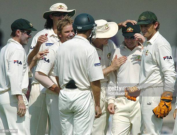 Australian cricketers celebrate the dismissal of unseen Indian batsman Venkatsai Laxman caught by Michael Clarke on the second day of the third Test...