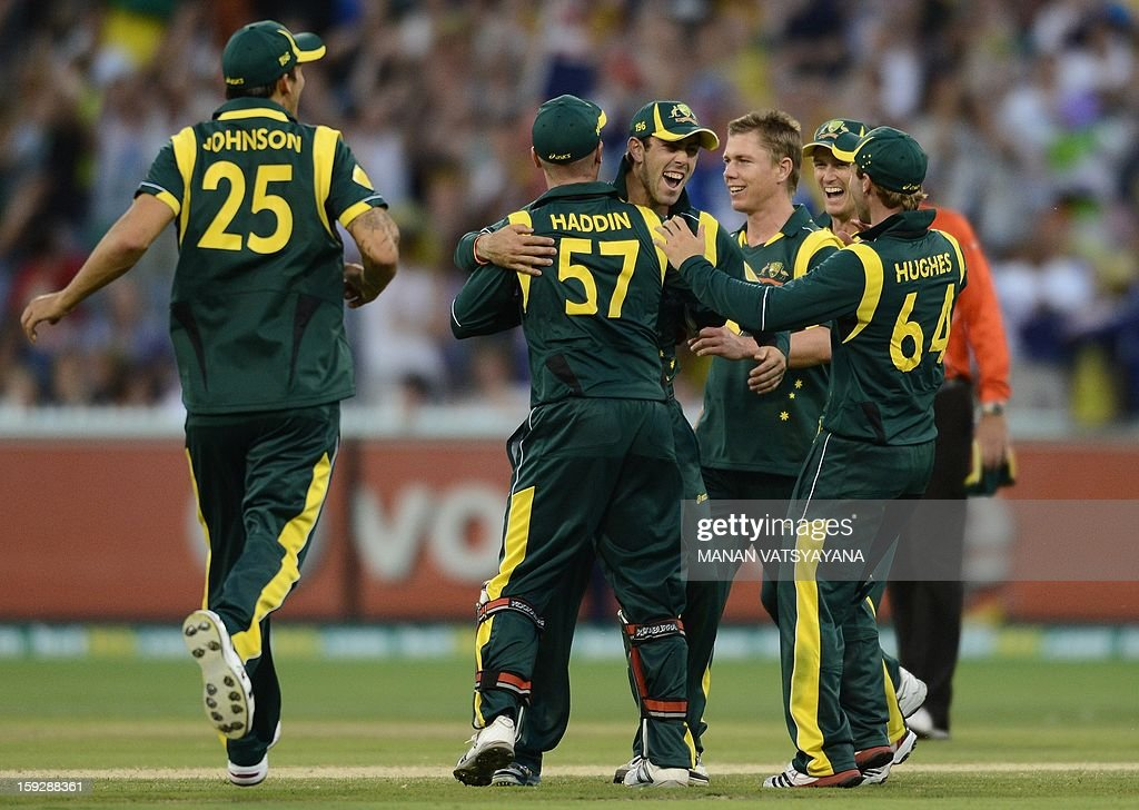 Australian cricketers celebrate the run-out of unseen Sri Lankan batsman Lahiru Thirimanne during the first one-day international between Australia and Sri Lanka at the Melbourne Cricket Ground on January 11, 2013.