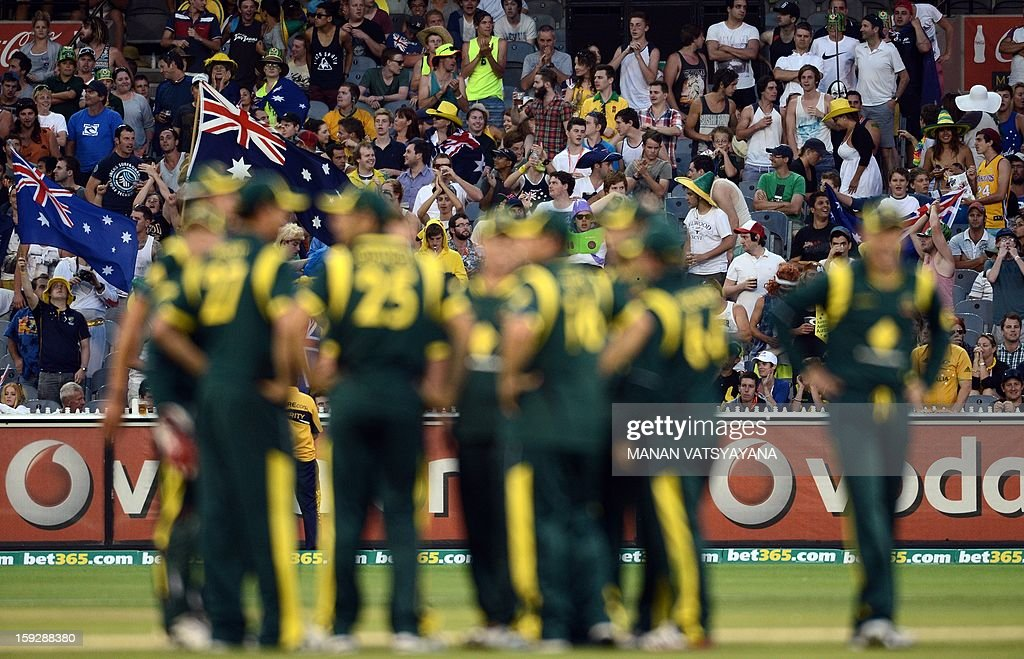 Australian cricketers celebrate the run-out of unseen Sri Lankan batsman Lahiru Thirimanne during the first one-day international between Australia and Sri Lanka at the Melbourne Cricket Ground on January 11, 2013. AFP PHOTO/ MANAN VATSYAYANA USE