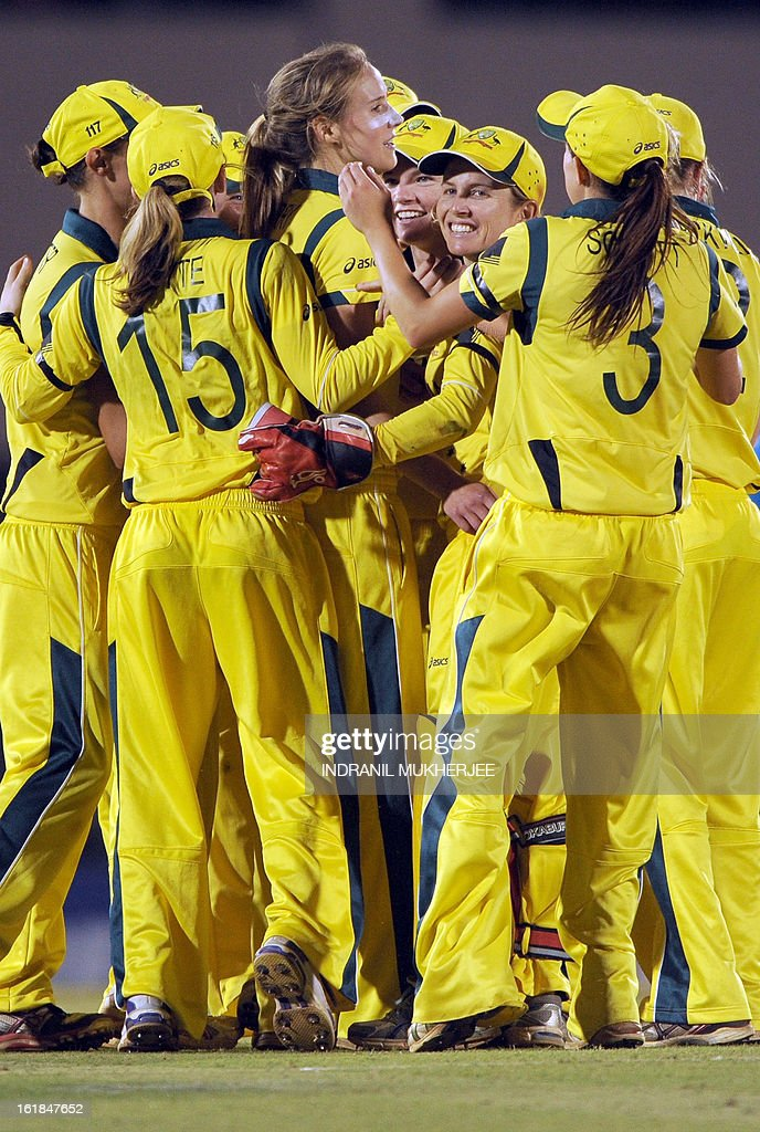 Australian cricketers gather around teammate Elysse Perry (C) to celebrate the wicket of unseen West Indies cricketer Stafanie Taylor during the final match of the ICC Women's World Cup 2013 between Australia and West Indies at the Cricket Club of India's Brabourne stadium in Mumbai on February 17, 2013. AFP PHOTO/Indranil MUKHERJEE