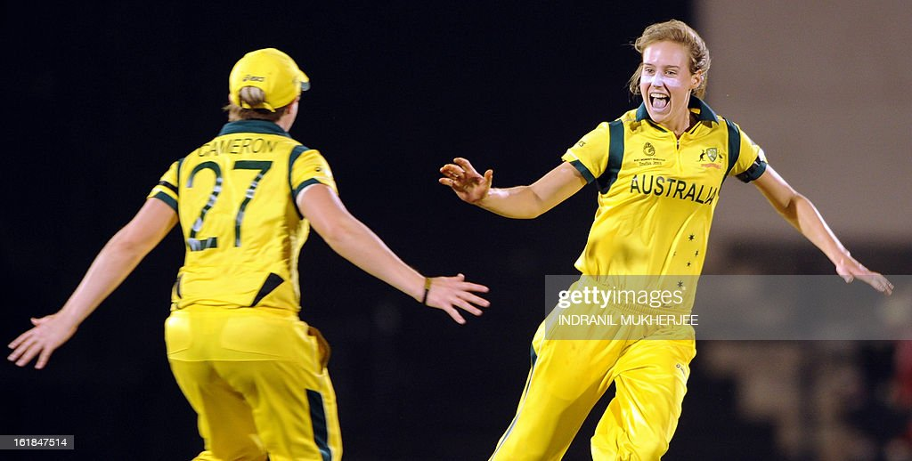 Australian cricketers Jess Cameron and Elysse Perry celebrate the wicket of unseen West Indies cricketer Stafanie Taylor during the final match of the ICC Women's World Cup 2013 between Australia and West Indies at the Cricket Club of India's Brabourne stadium in Mumbai on February 17, 2013. AFP PHOTO/Indranil MUKHERJEE