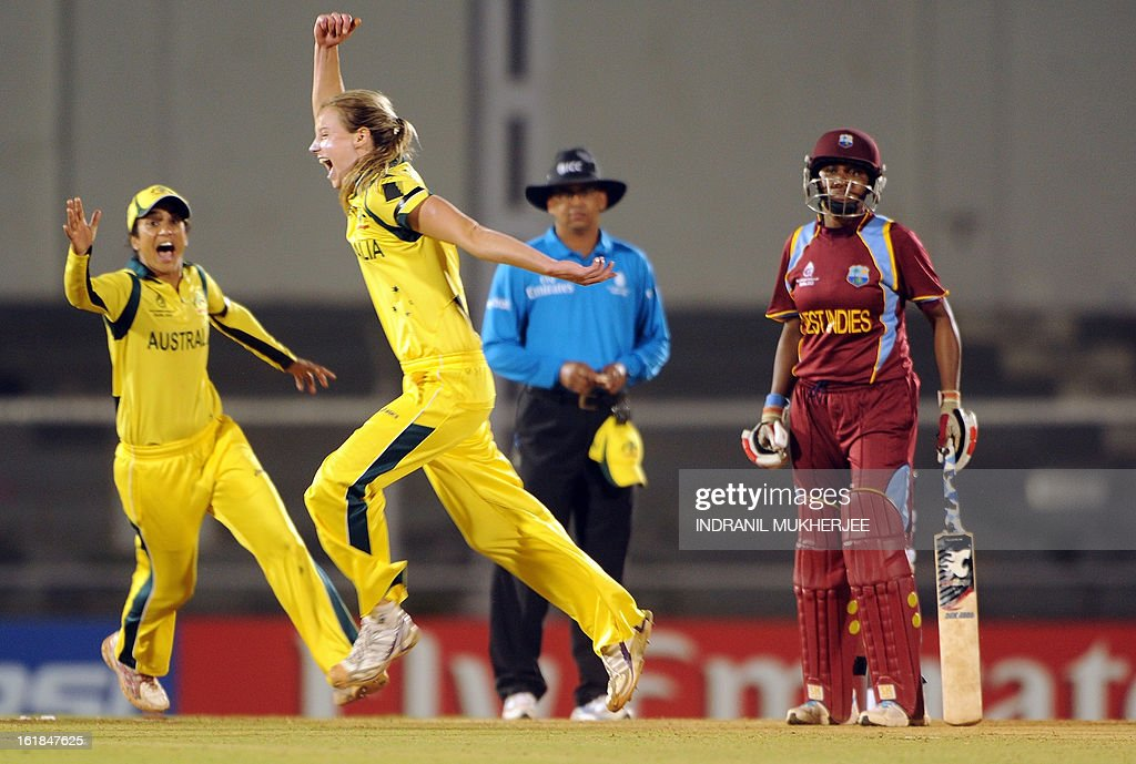 Australian cricketers Lisa Sthalekar (L) and Elysse Perry (C) celebrate the wicket of unseen West Indies cricketer Stafanie Taylor as non-striker Natasha McLean (R) looks on during the final match of the ICC Women's World Cup 2013 between Australia and West Indies at the Cricket Club of India's Brabourne stadium in Mumbai on February 17, 2013. AFP PHOTO/Indranil MUKHERJEE