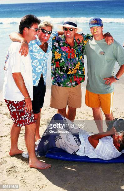 Australian cricketers Mark Waugh Shane Warne Mark Taylor and Steve Waugh pose for a beach cricket photo shoot October 1997 on the Gold Coast Australia