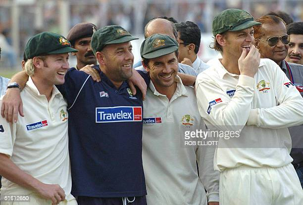 Australian cricketers Michael Clarke Darren Lehmann Justin Langer and Adam Gilchrist celebrate their win on the fourth day of the third Test between...