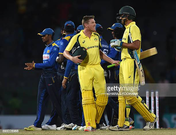 Australian cricketers Mitchell Starc and James Faulkner leave the grounds after victory in the first One Day International cricket match between Sri...