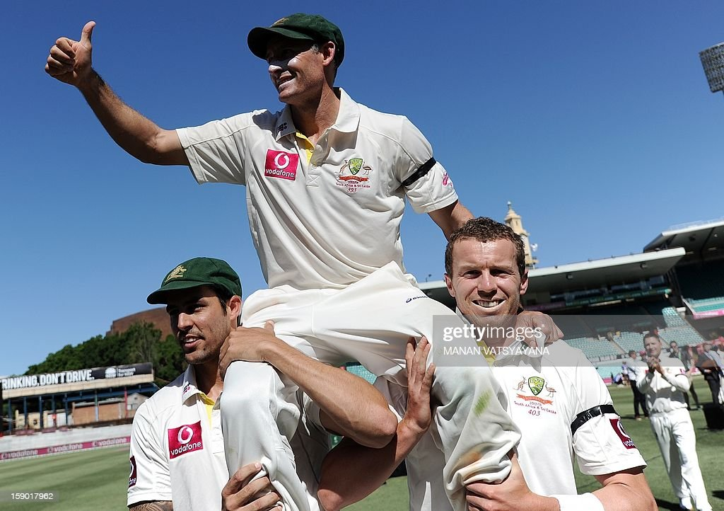 Australian cricketers Peter Siddle (R) and Mitchell Johnson (L) carry teammate Michael Hussey (C) off the field after defeating Sri Lanka on the fourth day of the third cricket Test between Australia and Sri Lanka at the Sydney Cricket Ground on January 6, 2013. Australia beat Sri Lanka in the three Test series 3-0.