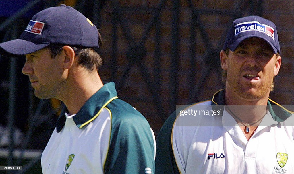 Australian cricketers Shane Warne (R) and Ricky Ponting (L) practice at the Harare Sports Club 20 May 2004 ahead of the match against Zimbabwe, which is supposed to start 22 May 2004. The match between Zimbabwe and Australia is now uncetain due to the squables between the Zimbabwe Cricket Union and Zimbabwean players.
