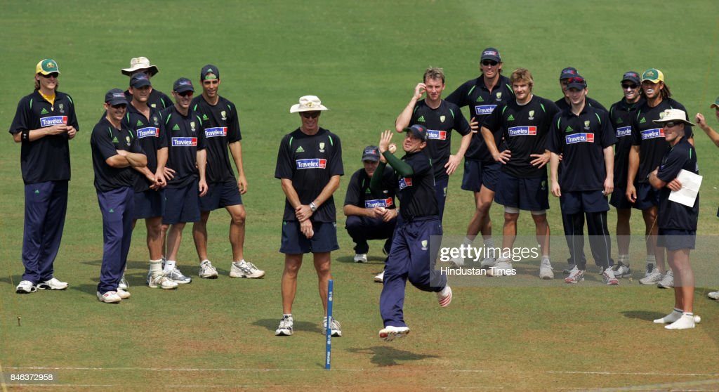 Australian cricketers watch their teammate Ricky Ponting practicing bowl in the nets, during the ICC Champions Trophy on Friday.