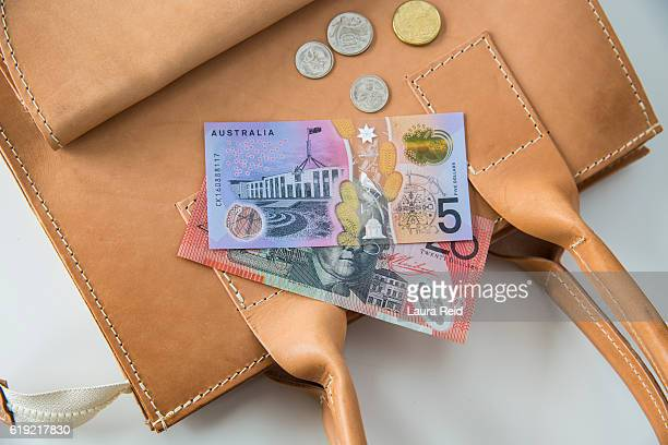 Australian currency resting on handbag