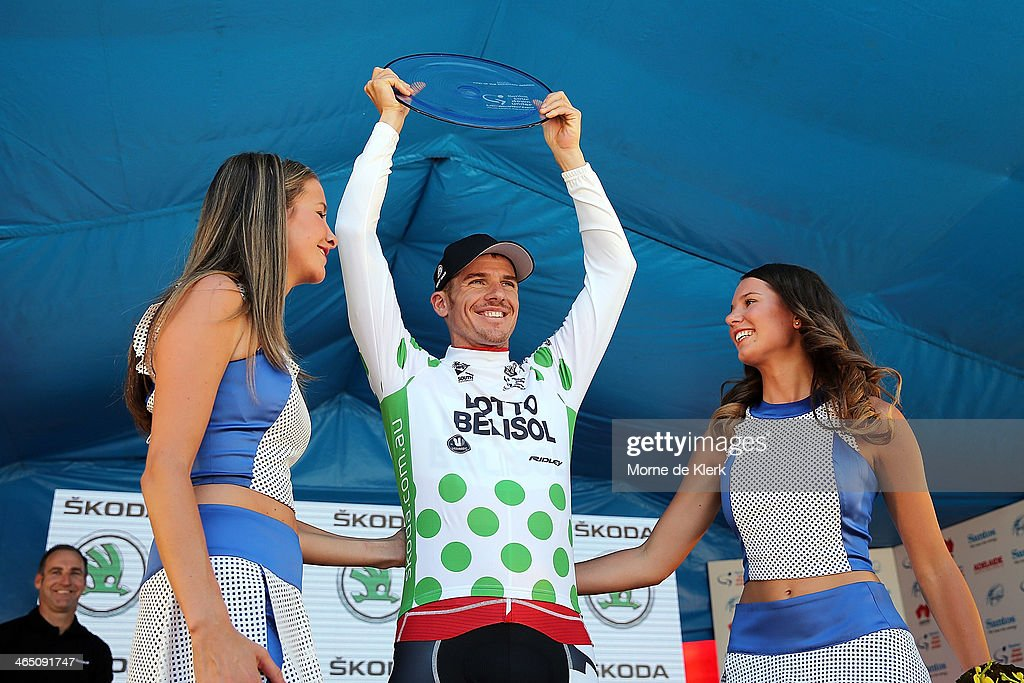 Australian cyclist <a gi-track='captionPersonalityLinkClicked' href=/galleries/search?phrase=Adam+Hansen&family=editorial&specificpeople=4105944 ng-click='$event.stopPropagation()'>Adam Hansen</a> of Lotto-Belisol celebrates on stage after winning the King of the Mountain award during Stage Six of the Tour Down Under on January 26, 2014 in Adelaide, Australia.