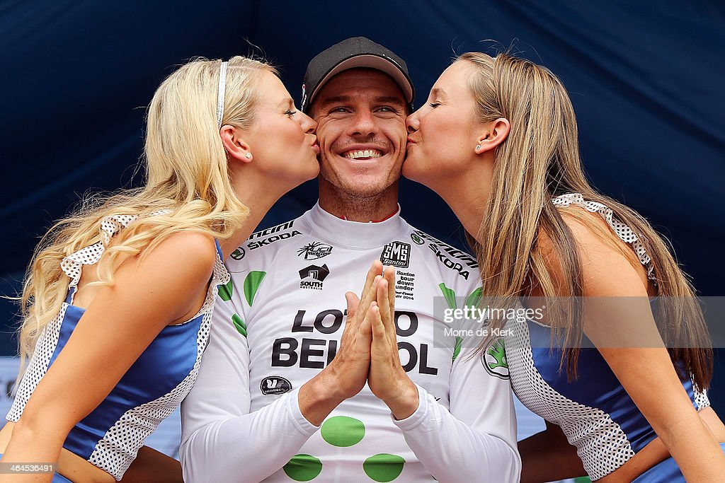 Australian cyclist <a gi-track='captionPersonalityLinkClicked' href=/galleries/search?phrase=Adam+Hansen&family=editorial&specificpeople=4105944 ng-click='$event.stopPropagation()'>Adam Hansen</a> of the Lotto-Belisol team celebrates on stage after he was presented with the King of the Mountain jersey after Stage Three of the Tour Down Under on January 23, 2014 in Adelaide, Australia.