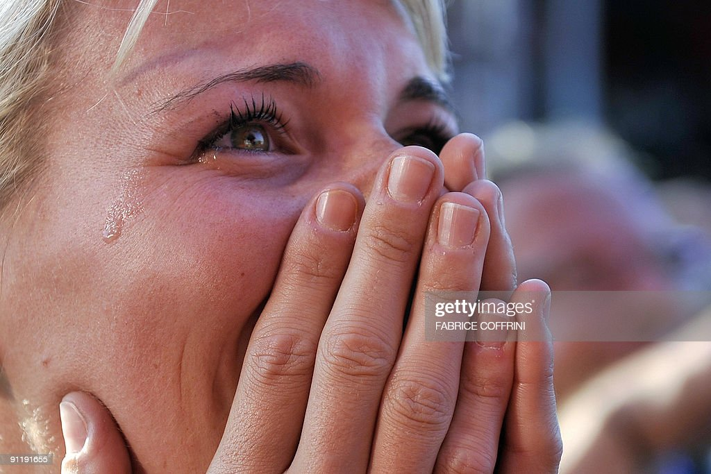 Australian Cyclist Cadel Evans' wife Chiara Passerini cries during the podium ceremony after his husband won the elite men's road race of the UCI cycling road World Championships on September 27, 2009 in Mendrisio, southern of Switzerland. Alexandr Kolobnev of Russia finished second with Spain's Joaquin Rodriguez finishing third, the pair coming over the line 27secs in arrears.