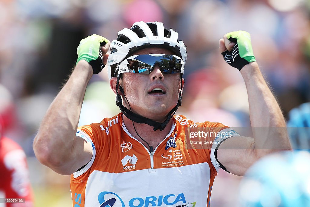 Australian cyclist <a gi-track='captionPersonalityLinkClicked' href=/galleries/search?phrase=Simon+Gerrans&family=editorial&specificpeople=750380 ng-click='$event.stopPropagation()'>Simon Gerrans</a> of Orica GreenEDGE celebrates as he crosses the finish line during Stage Six of the Tour Down Under on January 26, 2014 in Adelaide, Australia.