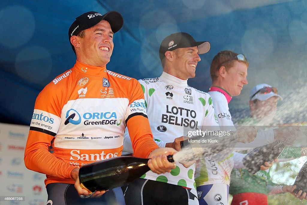 Australian cyclist <a gi-track='captionPersonalityLinkClicked' href=/galleries/search?phrase=Simon+Gerrans&family=editorial&specificpeople=750380 ng-click='$event.stopPropagation()'>Simon Gerrans</a> (L) of Orica GreenEDGE celebrates on stage with other classification winners after Stage Six of the Tour Down Under on January 26, 2014 in Adelaide, Australia.