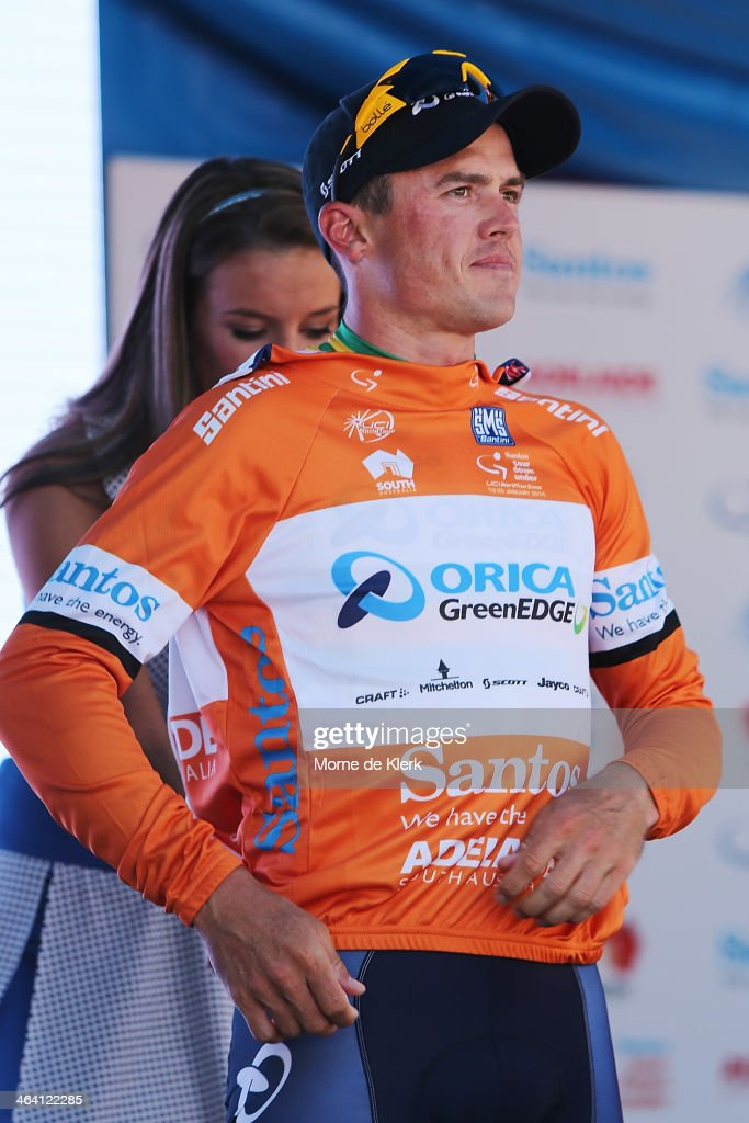 Australian cyclist Simon Gerrans of Orica GreenEDGE is presented with the race leaders ochre jersey after stage one of the Tour Down Under on January...