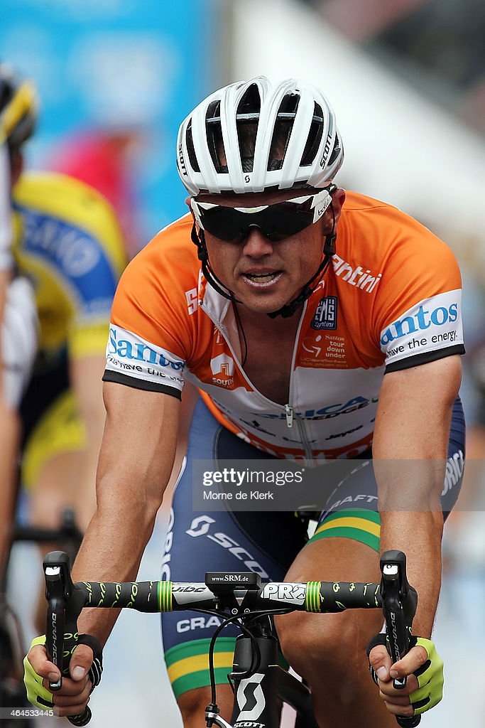 Australian cyclist Simon Gerrans of the Orica GreenEDGE team crosses the finish line at Stage Three of the Tour Down Under on January 23 2014 in...