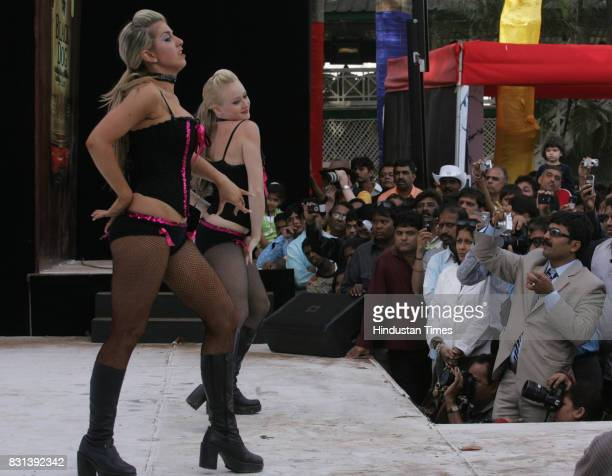 Australian dancers perform before the Indian Derby at Mahalaxmi Racecourse