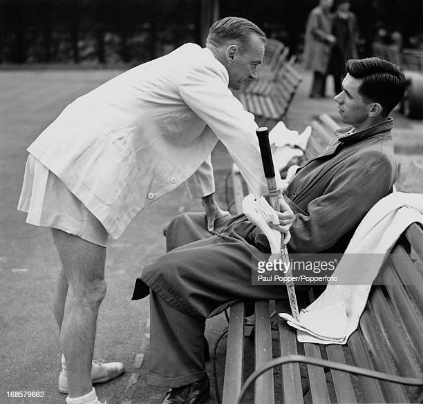 Australian Davis Cup team manager Harry Hopman has a word with one of his players during a break in practice at Wimbledon London 16th May 1950