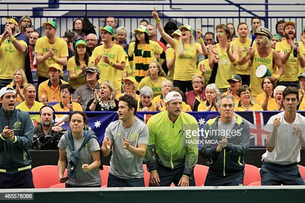 Australian Davis Cup team members Thanasi Kokkinakis and Samuel Groth cheer with other team members during the first round Davis Cup tennis match...
