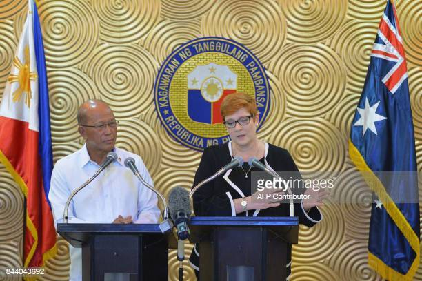 Australian Defence Minister Marise Payne speaks next to Philippine Defence Secretary Delfin Lorenzana during their joint press conference at a...