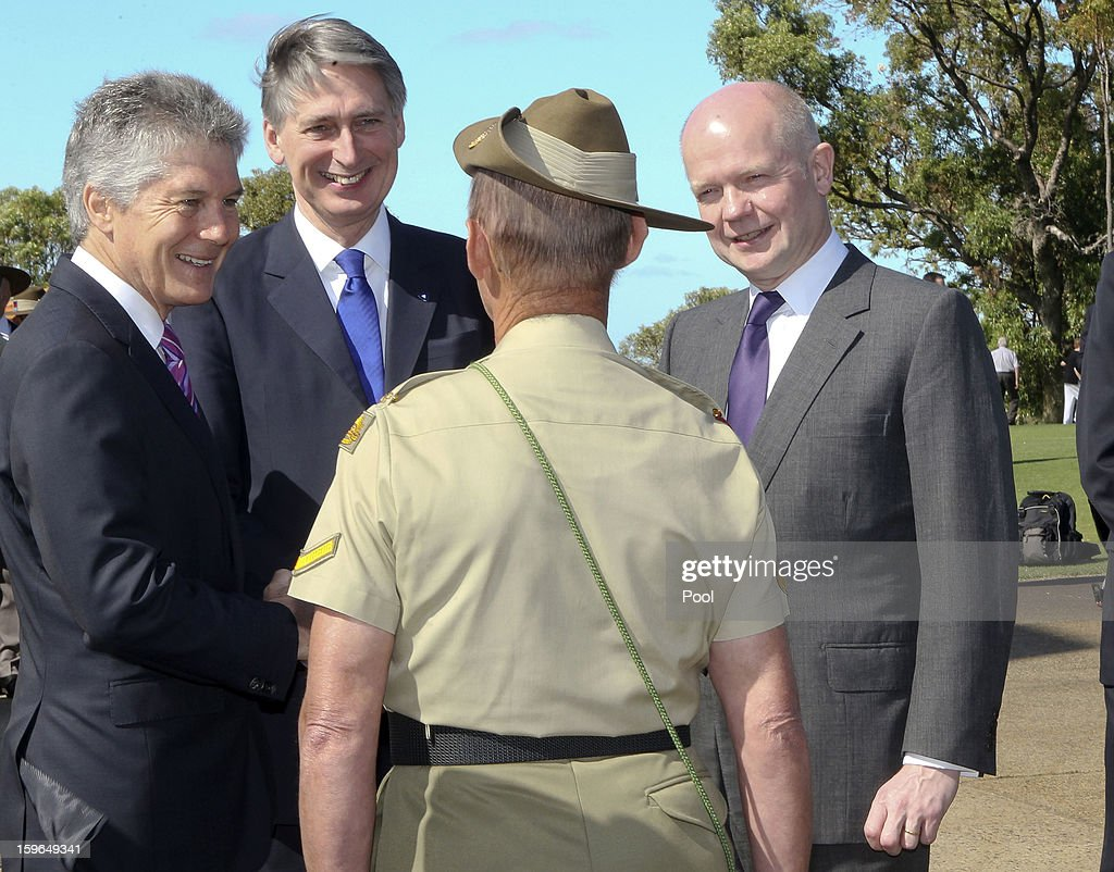 Australian Defence Minister Stephen Smith, British Defence Minister Philip Hammond and British Foreign Secretary William Hague talk to the bugler after the wreath-laying ceremony at Kings Park War Memorial before the commencement of the Australia-UK Ministerial Consultations (AUKMIN) on January 18, 2013 in Perth, Australia. The event is an annual day-long summit between the British Foreign Secretary and Defence Minister and their Australian counterparts.