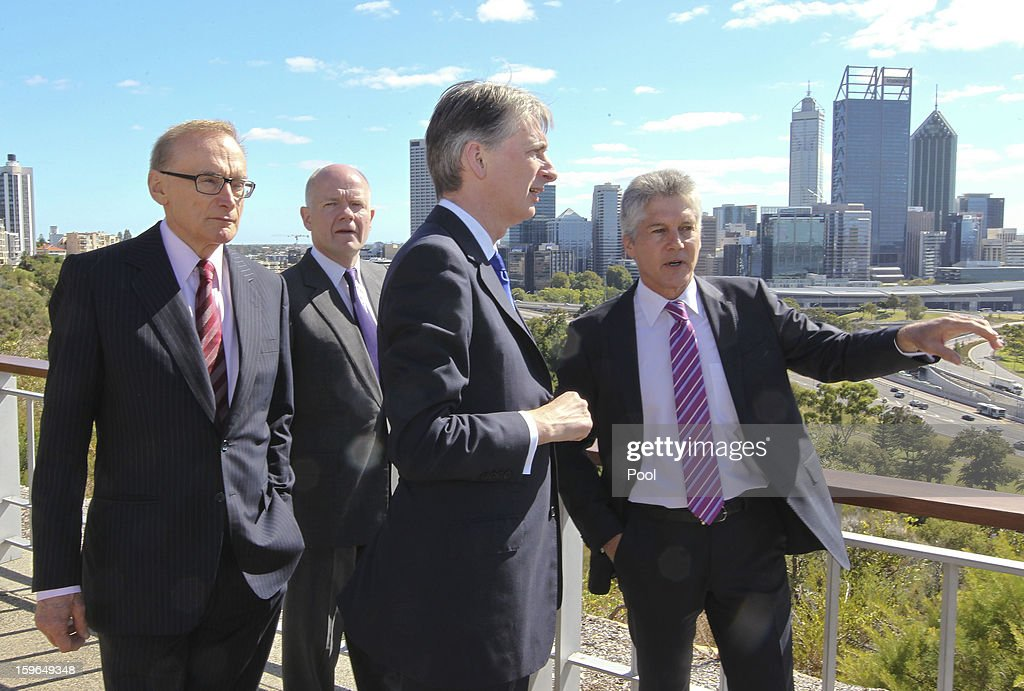 Australian Defence Minister Stephen Smith (R) shows his home city to Australian Foreign Minister <a gi-track='captionPersonalityLinkClicked' href=/galleries/search?phrase=Bob+Carr&family=editorial&specificpeople=209391 ng-click='$event.stopPropagation()'>Bob Carr</a> (L), British Foreign Secretary <a gi-track='captionPersonalityLinkClicked' href=/galleries/search?phrase=William+Hague&family=editorial&specificpeople=206295 ng-click='$event.stopPropagation()'>William Hague</a> (2nd L) and British Defence Minister <a gi-track='captionPersonalityLinkClicked' href=/galleries/search?phrase=Philip+Hammond&family=editorial&specificpeople=2486715 ng-click='$event.stopPropagation()'>Philip Hammond</a> at Kings Park War Memorial before the commencement of the Australia-UK Ministerial Consultations (AUKMIN) on January 18, 2013 in Perth, Australia. The event is an annual day-long summit between the British Foreign Secretary and Defence Minister and their Australian counterparts.