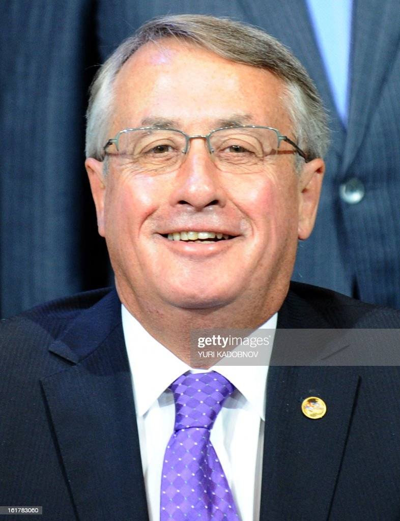 Australian Deputy Prime Minister and Treasurer Wayne Swan smiles as he poses for family picture after a meeting of G20 states finance ministers in Moscow, on February 16, 2013. The ministers and central bank governors' deputies gathered today in Moscow for their first meeting in the Russian capital aimed at reassuring markets that the world's economic powers would not slug it out in 'currency wars' to boost national growth. AFP HOTO/YURI KADOBNOV