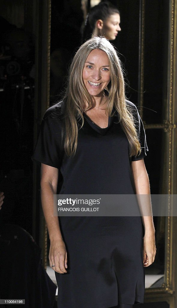 Australian designer Collette Dinnigan acknowledges the public following the Autumn/Winter 20112012 readytowear collection show on March 8 2011 in...