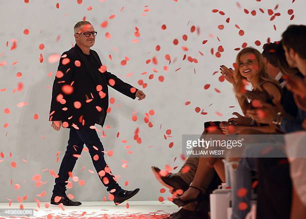 Australian designer Jason Brunsdon acknowledges the applause after a parade of his garments at Fashion Week Australia in Sydney on April 14 2015 AFP...