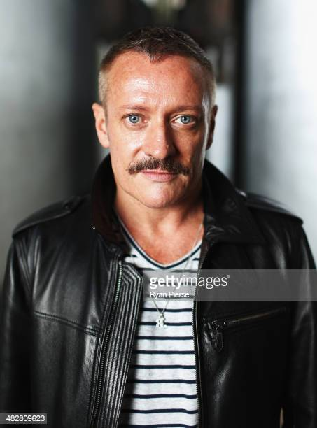 Australian designer Jayson Brunsden poses for a portrait ahead of MercedesBenz Fashion Week Australia 2014 on April 5 2014 in Sydney Australia...