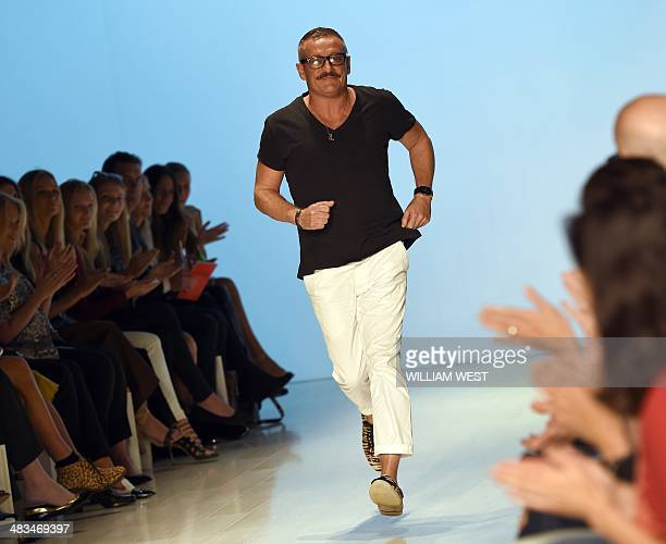 Australian designer Jayson Brunsdon acknowledges the applause after a parade of his collection at Fashion Week Australia in Sydney on April 9 2014...