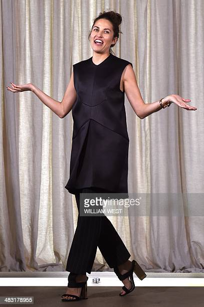 Australian designer Kym Ellery acknowledges the applause after parading her label Ellery at Fashion Week Australia in Sydney on April 7 2014 The...
