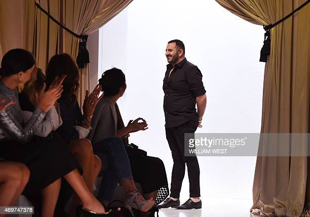 Australian designer Steven Khalil acknowledges the applause after a parade of his garments during Fashion Week Australia in Sydney on April 15 2015...