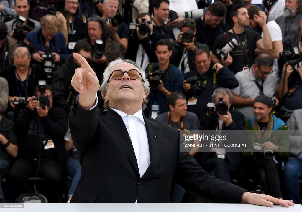 TOPSHOT Australian director and President of the Jury George Miller gestures as he poses on May 11 2016 during a photocall ahead of the opening of...