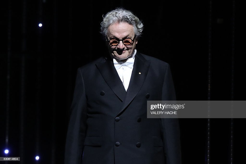 TOPSHOT Australian director and President of the Jury George Miller smiles as he arrives on stage on May 11 2016 during the opening ceremony for the...